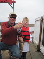 Dad and Bryce and brown rock fish