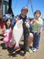 Ho Kim family and halibut and lingcod