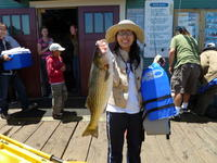 Capitola: Phoung with a striper.