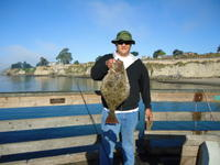 Capitola: Noel with a halibut