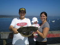 Ryan and wife and daughter and halibut