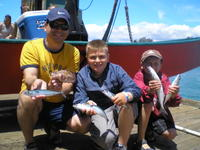 Dad, Logan, Preston and mackerel and jacksmelt