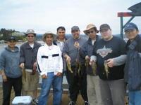 Bunch of guys, fish