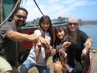 Kyannah and Family and rock fish